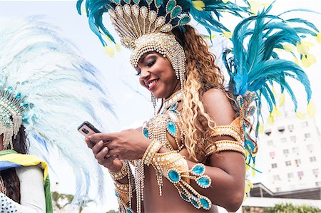 Samba dancer using cellphone, Rio De Janeiro, Brazil Stock Photo - Premium Royalty-Free, Code: 649-07119525