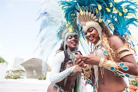 Samba dancers using cellphone, Rio De Janeiro, Brazil Stock Photo - Premium Royalty-Free, Code: 649-07119526