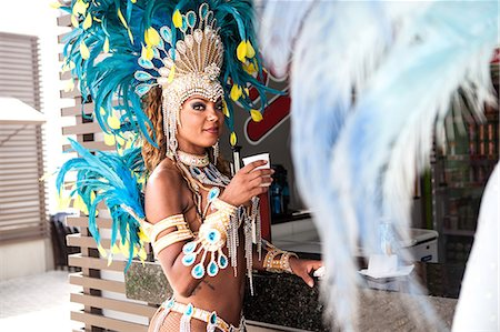 Samba dancer with refreshment, Rio De Janeiro, Brazil Stock Photo - Premium Royalty-Free, Code: 649-07119521