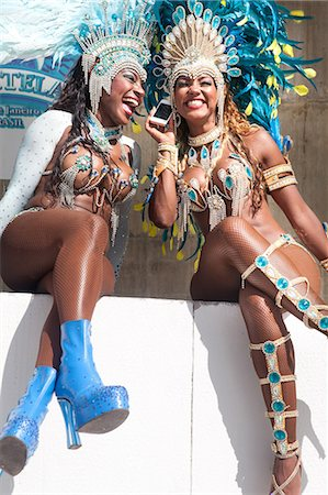 Samba dancers using cellphone, Rio De Janeiro, Brazil Stock Photo - Premium Royalty-Free, Code: 649-07119530
