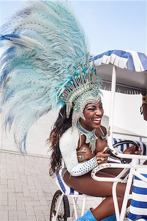 Samba dancer riding cart, Rio De Janeiro, Brazil Stock Photo - Premium Royalty-Free, Code: 649-07119533