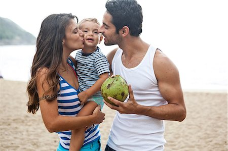 Family on beach, mother kissing son on cheek Stock Photo - Premium Royalty-Free, Code: 649-07119663