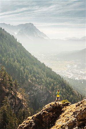 Man standing on mountain, Farchant, Bavaria, Germany Stock Photo - Premium Royalty-Free, Code: 649-07119706