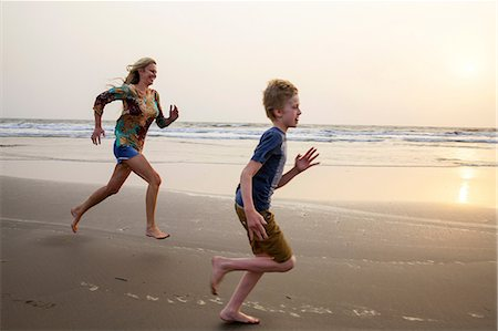 Mother and son running on beach Stock Photo - Premium Royalty-Free, Code: 649-07119734
