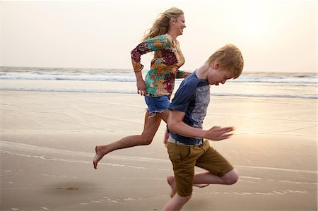 Mother and son running on beach Stock Photo - Premium Royalty-Free, Code: 649-07119735