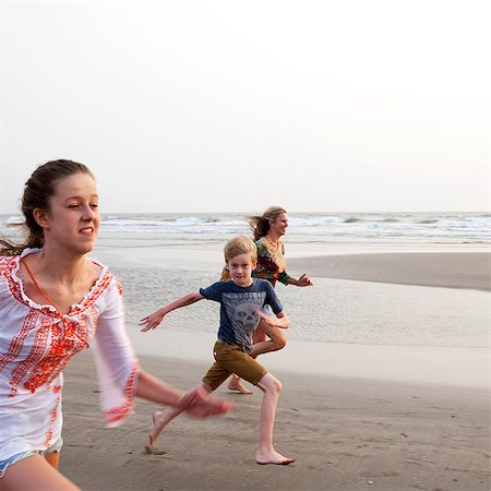 Mother, son and daughter running on beach Stock Photo - Premium Royalty-Free, Code: 649-07119732