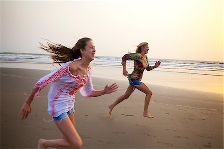 Mother and daughter running on beach Stock Photo - Premium Royalty-Free, Code: 649-07119733