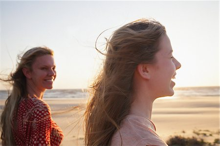 Mother and daughter on windy beach, close up Stock Photo - Premium Royalty-Free, Code: 649-07119748