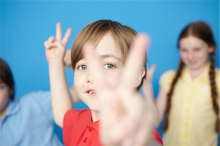 preteens fingering - Portrait of boy making peace sign Stock Photo - Premium Royalty-Free, Code: 649-07119798