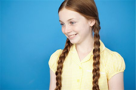red hair preteen girl - Portrait of girl with plaits wearing yellow school dress Stock Photo - Premium Royalty-Free, Code: 649-07119801