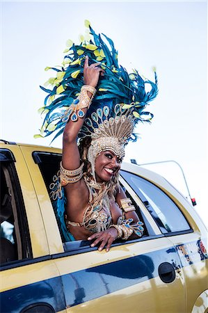 Samba dancer in a taxi cab, Ipanema Beach, Rio De Janeiro, Brazil Stock Photo - Premium Royalty-Free, Code: 649-07119858