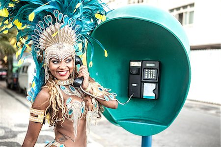 Samba dancer using pay phone, Ipanema Beach, Rio De Janeiro, Brazil Stock Photo - Premium Royalty-Free, Code: 649-07119864
