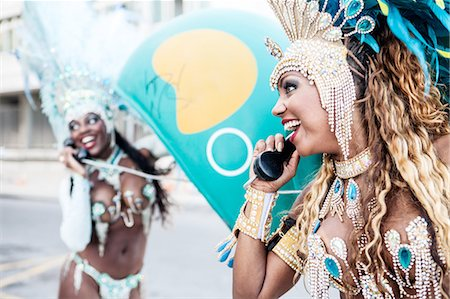 Samba dancers using pay phones, Ipanema Beach, Rio De Janeiro, Brazil Stock Photo - Premium Royalty-Free, Code: 649-07119865