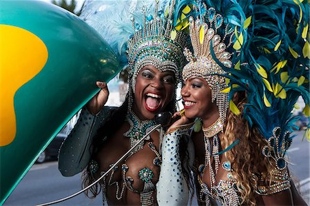 Samba dancers using pay phone, Ipanema Beach, Rio De Janeiro, Brazil Stock Photo - Premium Royalty-Free, Code: 649-07119866