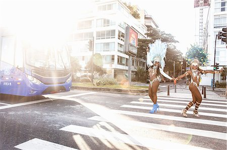 Samba dancers crossing a road, Ipanema Beach, Rio De Janeiro, Brazil Stock Photo - Premium Royalty-Free, Code: 649-07119867
