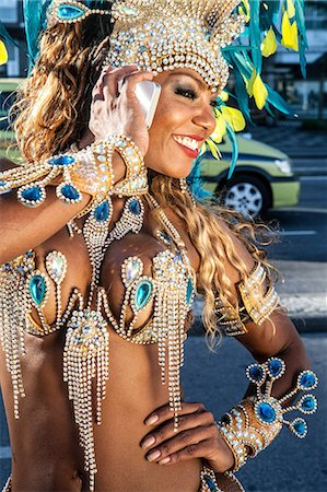 Samba dancer using cellphone, Ipanema Beach, Rio De Janeiro, Brazil Stock Photo - Premium Royalty-Free, Code: 649-07119868