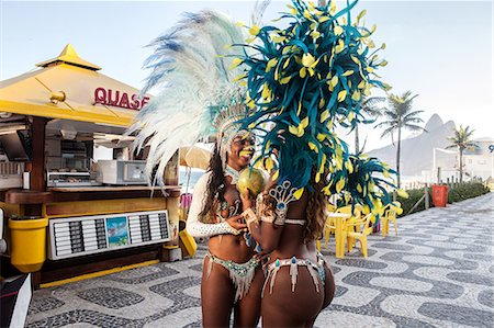 Samba dancers drinking coconut drink, Ipanema Beach, Rio De Janeiro, Brazil Stock Photo - Premium Royalty-Free, Code: 649-07119869