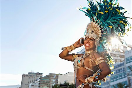 Samba dancer using cellphone, Ipanema Beach, Rio De Janeiro, Brazil Stock Photo - Premium Royalty-Free, Code: 649-07119860
