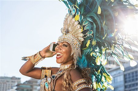 Samba dancer using cellphone, Ipanema Beach, Rio De Janeiro, Brazil Stock Photo - Premium Royalty-Free, Code: 649-07119861