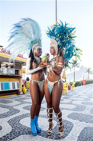 Samba dancers drinking coconut drink, Ipanema Beach, Rio De Janeiro, Brazil Stock Photo - Premium Royalty-Free, Code: 649-07119870
