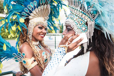 Samba dancers with cellphone, Rio De Janeiro, Brazil Stock Photo - Premium Royalty-Free, Code: 649-07119871
