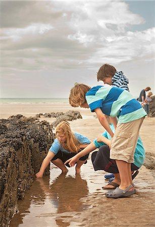 preteen beach - Friends looking in rock pool Stock Photo - Premium Royalty-Free, Code: 649-07119889