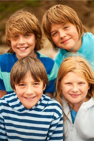 Portrait of four friends smiling at camera Stock Photo - Premium Royalty-Free, Code: 649-07119882