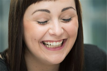 Young woman laughing, eyes closed Stock Photo - Premium Royalty-Free, Code: 649-07238253