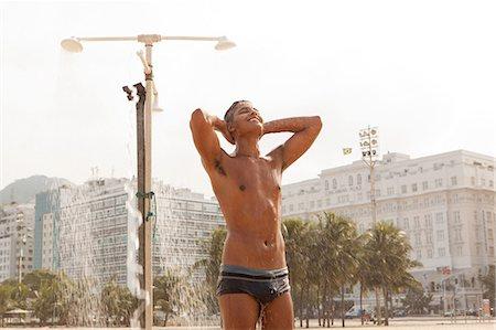 shower - Young man showering on Copacabana Beach, Rio de Janeiro, Brazil Stock Photo - Premium Royalty-Free, Code: 649-07238294