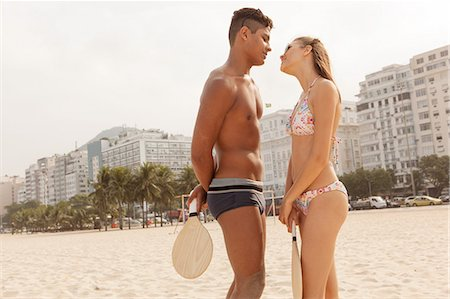 Young couple about to kiss on Copacabana Beach, Rio de Janeiro, Brazil Stock Photo - Premium Royalty-Free, Code: 649-07238298