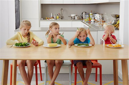 Children refusing to eat vegetables Stock Photo - Premium Royalty-Free, Code: 649-07238343