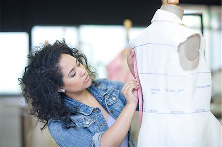 designer (female) - Fashion design student measuring in class Stock Photo - Premium Royalty-Free, Code: 649-07238384