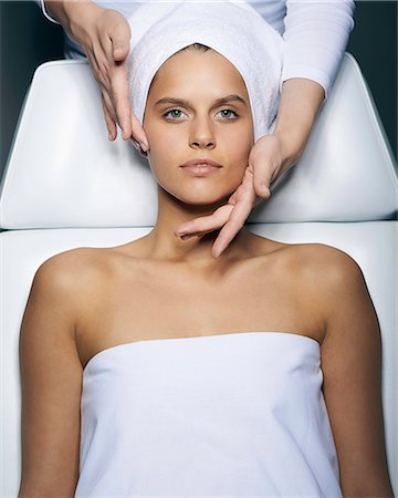 Young woman having facial treatment Stock Photo - Premium Royalty-Free, Code: 649-07238426