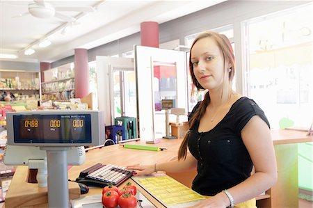 Woman working in organic food market, serving at cash register Stock Photo - Premium Royalty-Free, Code: 649-07238423