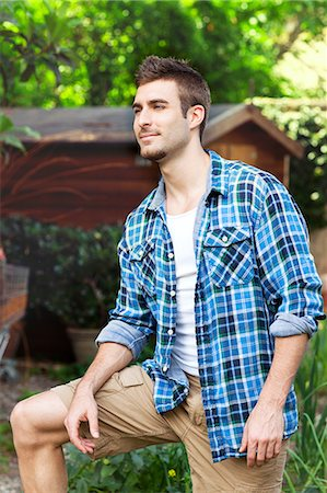 Portrait of young man wearing blue checked shirt Stock Photo - Premium Royalty-Free, Code: 649-07238531