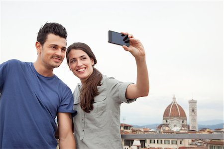 Couple photographing themselves with Florence Cathedral, Florence, Tuscany, Italy Stock Photo - Premium Royalty-Free, Code: 649-07238558