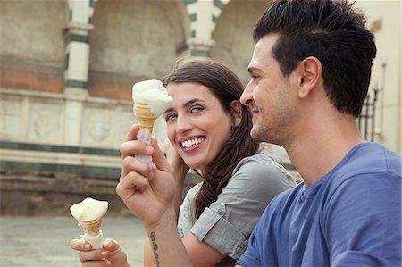 Couple eating ice creams, Santa Maria Novella square, Florence, Tuscany, Italy Stock Photo - Premium Royalty-Free, Code: 649-07238559