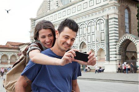 Young couple outside Santa Maria Novella church, Florence, Tuscany, Italy Stock Photo - Premium Royalty-Free, Code: 649-07238550