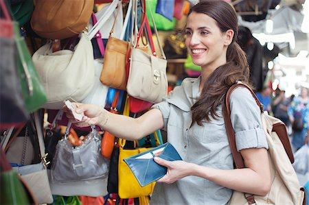 Young woman buying handbag, San Lorenzo market, Florence, Tuscany, Italy Stock Photo - Premium Royalty-Free, Code: 649-07238564