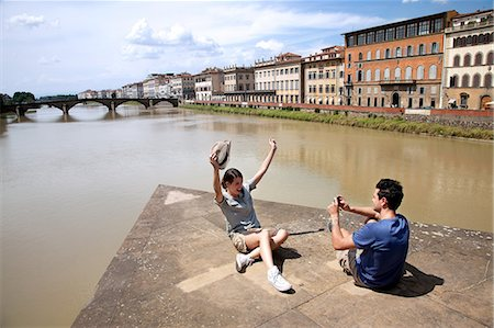 Man photographing woman with Ponte alle Grazie in background, Florence, Tuscany, Italy Stock Photo - Premium Royalty-Free, Code: 649-07238571