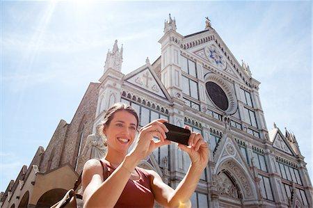 Woman outside Santa Croce church, Piazza di Santa Croce, Florence, Tuscany, Italy Stock Photo - Premium Royalty-Free, Code: 649-07238585