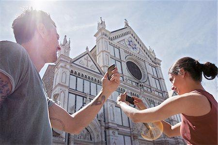Man and woman photogrpahing Church of Santa Croce, Piazza di Santa Croce, Florence, Tuscany, Italy Stock Photo - Premium Royalty-Free, Code: 649-07238586