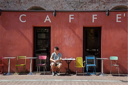 red chair - Young man sitting outside cafe, Florence, Tuscany, Italy Stock Photo - Premium Royalty-Free, Code: 649-07238597