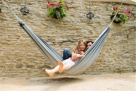 Portrait of mother and daughter in hammock Stock Photo - Premium Royalty-Free, Code: 649-07238625
