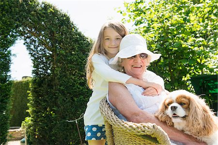 Portrait of grandmother and granddaughter with dog Stock Photo - Premium Royalty-Free, Code: 649-07238636