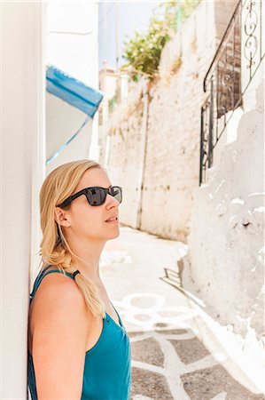 Woman standing in street in Vourliotes, Samos, Greece Stock Photo - Premium Royalty-Free, Code: 649-07238664