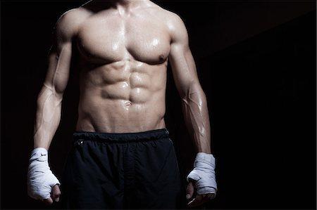 Muscular torso of boxer Stock Photo - Premium Royalty-Free, Code: 649-07238776