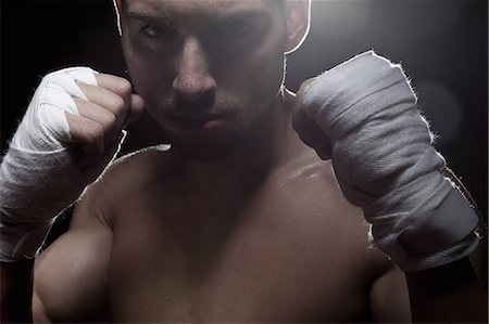 power - Boxer with bandaged hands Stock Photo - Premium Royalty-Free, Code: 649-07238779