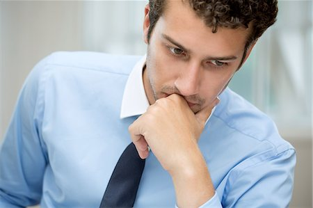Young man in deep thought Stock Photo - Premium Royalty-Free, Code: 649-07238900
