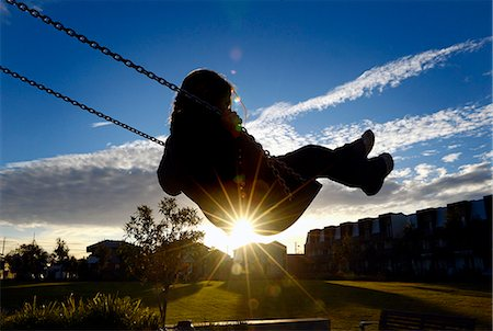 swing (sports) - Young girl on swing at sunset Stock Photo - Premium Royalty-Free, Code: 649-07238927
